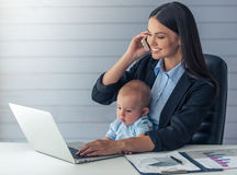 Business lady with her baby Royalty Free Stock Photography