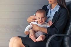 Business lady with her baby Stock Photo
