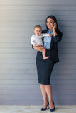Business lady with her baby Royalty Free Stock Image