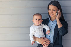Business lady with her baby Stock Image