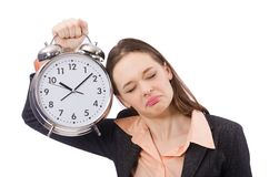 Business lady holding alarm clock isolated on Royalty Free Stock Images