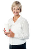 Business lady holding beverage Stock Image