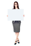 Business lady holding a blank billboard Stock Photos
