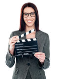 Business lady holding clapperboard Royalty Free Stock Image