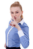Business lady holding her finger near the mouth Royalty Free Stock Photography