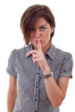 Business lady holding her finger near the mouth Stock Photography