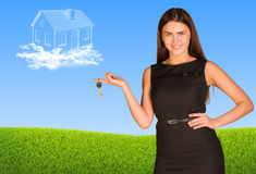 Business lady holding keys and clouds in form of Stock Images