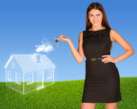 Business lady holding keys and clouds in form of Stock Photography