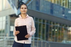 Business lady holds the black folder in hand Stock Images