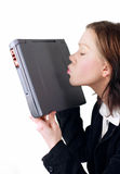 Business lady kissing laptop Stock Photo