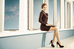 Business lady with laptop Stock Photography