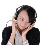 Business lady listen music Stock Image