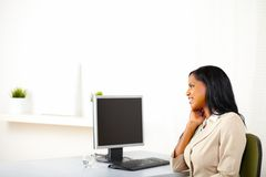 Business lady looking to the screen Royalty Free Stock Photos