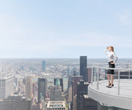 Business lady looks at the New York city Stock Photos