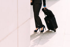 Business lady with luggage. Cropped image of elegant business lady with luggage at the station Stock Image