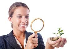 Business lady with magnifying glass isolated on Royalty Free Stock Photos