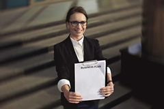 Business lady or manager who white business plan. Royalty Free Stock Image