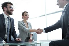 Business lady meets her business partner. Welcome and handshake business women with a business partner royalty free stock image