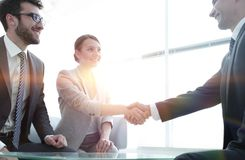 Business lady meets her business partner. Welcome and handshake business women with a business partner stock photo