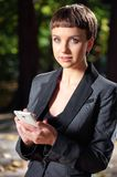 Business lady with mobile phone. Royalty Free Stock Image