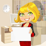 Business lady in office showing blank banner Royalty Free Stock Photos