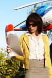 Business lady with papaers over flying helicopter Royalty Free Stock Photography