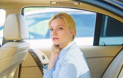 Business lady passenger luxury car salon. Personal assistant and driver. Business life concept. Business woman sit on. Backseat. Busy lady passenger leather car stock photography
