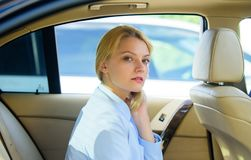 Business lady passenger luxury car salon. Personal assistant and driver. Business life concept. Business woman sit on. Backseat. Busy lady passenger leather car royalty free stock photography