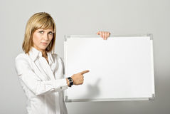 Business Lady pointing to Whiteboard Stock Photography