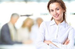 Business lady with positive look. And cheerful smile posing for the camera Stock Photography