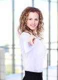 Business lady with positive look. And cheerful smile posing for the camera Royalty Free Stock Images