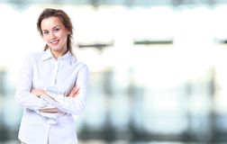 Business lady with positive look. And cheerful smile posing for the camera Stock Image