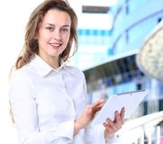 Business lady with positive look. And cheerful smile posing for the camera Stock Photos