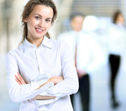 Business lady with positive look and cheerful smile posing. For the camera Stock Photos