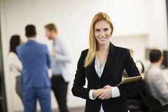 Business lady with positive look and cheerful smile posing for camera royalty free stock images