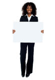 Business lady promoting big blank banner ad. Isolated on white Royalty Free Stock Photos