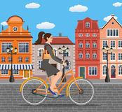 Business lady riding on a cruiser bicycle. Royalty Free Stock Photos