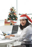 Business lady in Santa hat Royalty Free Stock Photo