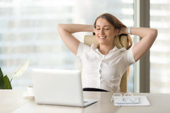 Business lady satisfied watching completed work Royalty Free Stock Photography