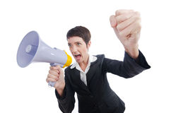 Business lady screaming to loudspeaker. Young business lady screaming to loudspeaker Royalty Free Stock Photography