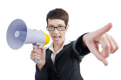 Business lady screaming to loudspeaker. Young business lady screaming to loudspeaker Royalty Free Stock Images