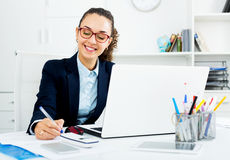 Business Lady Sitting At Office Desk With Laptop Royalty Free Stock Photo