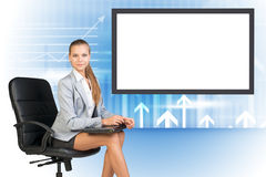 Business lady sitting in chair with laptop stock photography