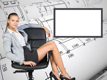 Business lady sitting in relaxed posture Stock Photography