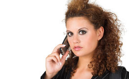 Business lady speaking on cell phone. Portrait of a pretty business lady speaking on the cell phone taken on white background; copy space Royalty Free Stock Image