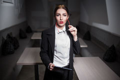 Business lady in suit and with red lips and with tablet;. Sexy serious woman with red glasses keeps tablet; strong businesswoman in suit; corporate business Stock Photography