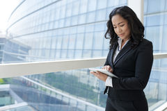 Business lady with tablet. Portrait of Asian business lady using digital tablet Royalty Free Stock Images