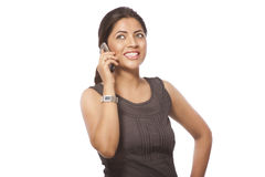 Business Lady Talking on Phone. Portrait of business lady talking on phone over white background stock photos