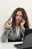 Business lady talking on the phone with credit car Royalty Free Stock Photography
