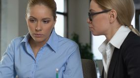 Business lady teaching younger colleague office, teamwork project, collaboration. Stock footage stock video